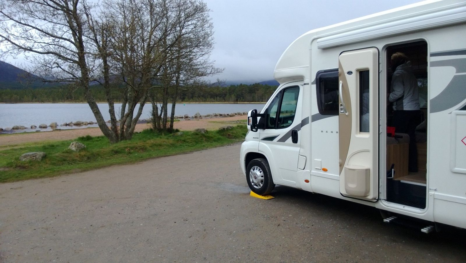 Motorhome parked by banks of loch