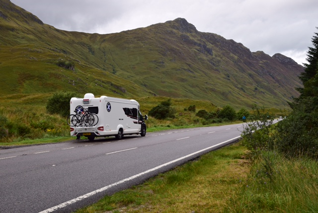 driving through the rugged mountains ranges in a motorhome
