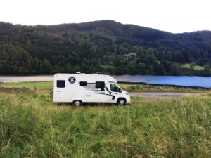 wild camping with your rental motorohme enjoying the view by the loch