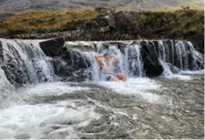 Customer enjoying a dip at the fairy pools