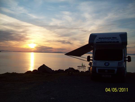 Sunset with Scotish Tourer