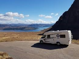 Scottish tourer motorhome parked by the sea